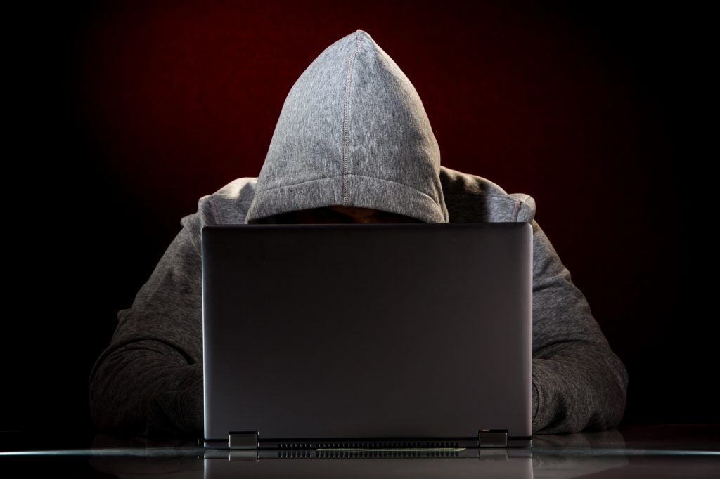 Hacker with laptop